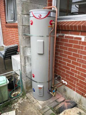 Outdoor hot water cylinder relocation